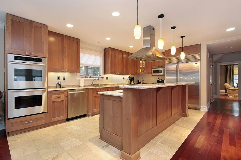 Beautiful Kitchen with Island and two tone multi-surface flooring Showcasing Cabinet Refacing