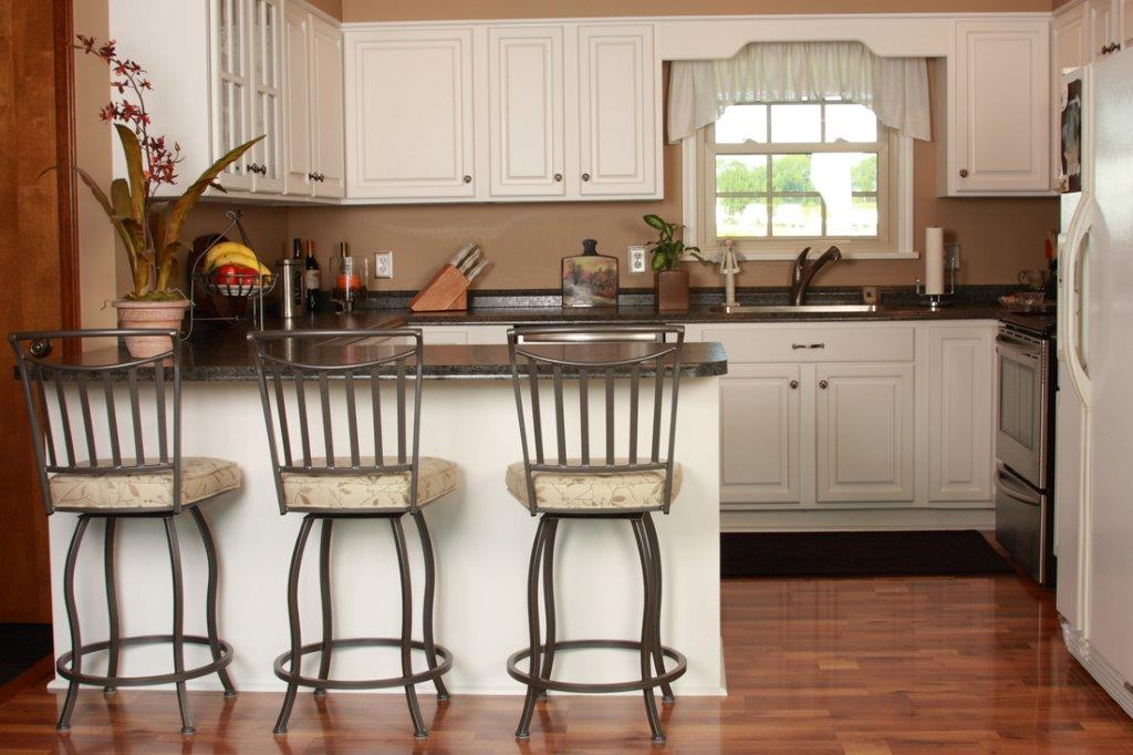 Compact Kitchen Showcasing Cabinet Refacing